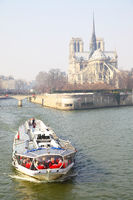 Pleasure boat near Notre Dame de Paris