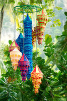 Traditional oriental lanterns hanging on the tree
