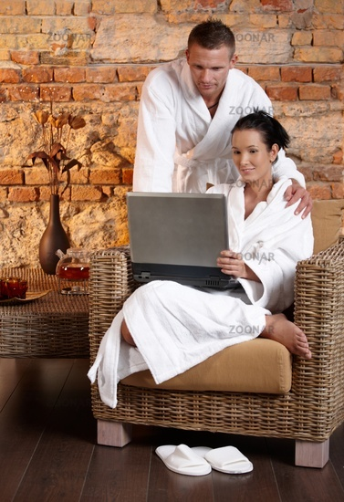 Couple in wellness using laptop