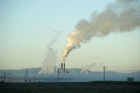 View of sugar processing plant behind fog