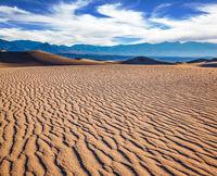 Small ripples on sand dunes