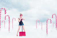 Pin-up girl with snow shovel