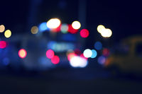 Colorized blurred street and car lights, urban abstract night time background