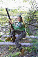 Beautiful young woman on a hunt in Siberia