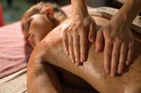 Masseur massaging girl's body. Close-up of hands