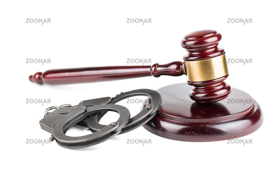 Gavel and handcuffs on white background