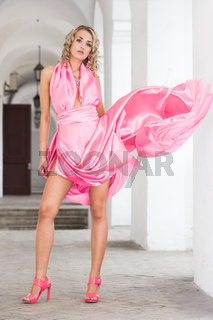 beautiful fashionable woman in pink dress