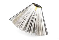 fanned book photographed from above