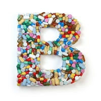 Letter B. Set of alphabet of medicine pills, capsules, tablets and blisters isolated on white.