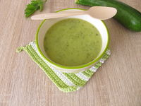 Homemade zucchini soup in soup bowl
