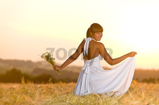 Romantic woman in sunset corn field wear dress