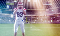 American Football Player isolated on big modern stadium field