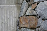 retaining wall of large gray stones and concrete
