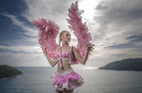 Beautiful angel woman with pink wings