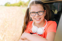 Cute smiling girl with headphones outdoor