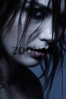 Close-up grunge portrait of young brunette woman in depression