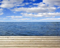 Wooden plank with sea and blue sky