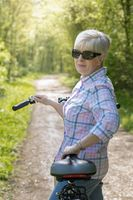 A senior woman with short gray hair and bicycle