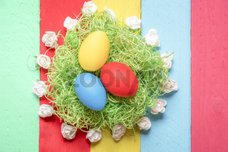 Easter eggs surrounded by roses