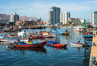 Colourful wooden fishing boats in the harbour at Antofagasta in the Atacama Region of Chile