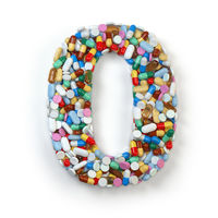 Number 0 zero. Set of alphabet of medicine pills, capsules, tablets and blisters isolated on white.