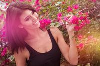 Pretty woman between pink flowers