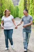 Young and happy loving couple on a romantic walk outdoors in park