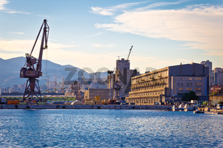 Port city of Rijeka cranes and industrial zone in harbor view