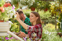 Man and woman with flowers in garden