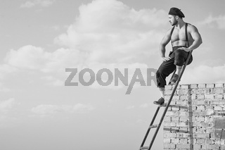 Retro construction worker climbing a ladder while working on the