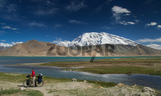 Cyclist at Kara Kul lake