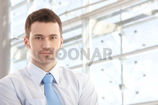 Portrait of handsome businessman smiling