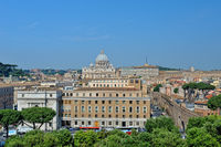 Cityscape of Rome, View to the St. Peter cathedral from roofs.
