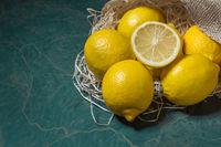 Fresh lemons stacked on jute sack