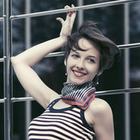 Happy young fashion woman in tank top and silk scarf outdoor