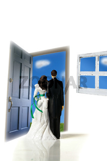plastic cake-topper wedding couple looking out a door
