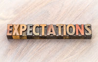 expectations word abstract in wood type