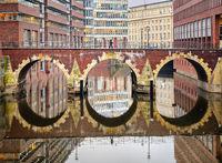 Bridge reflecting in canal in Hamburg city, Germany