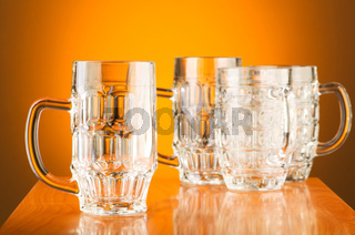 Beer glass against gradient background