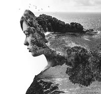 Double exposure. Portrait of a woman combined with a rocky coast and sea. Black and white