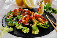 Barbecue grilled prawns with guacamole salad