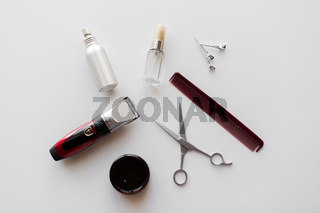 styling hair spray, trimmer and scissors