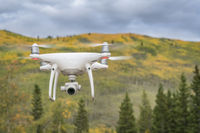 Phantom drone flying in mountains