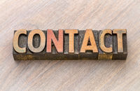contact word abstract in wood type