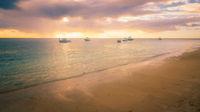 Fishing boats moored at sunset