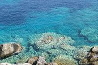 rocks in the turquoise ocean