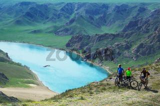 Adventure mountain biking on riverside