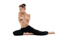 Nudity and yoga. Photo of topless brunette posing