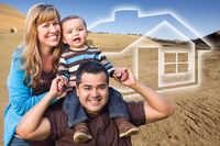 Mixed Race Family at Construction Site with Ghoosted House Behind
