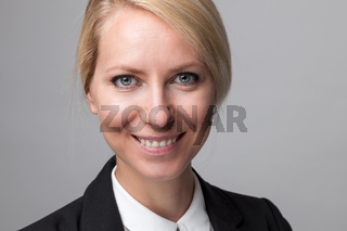 Closeup headshot of young and happy business woman